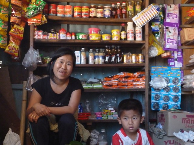 Lalringliani at her shop with her son