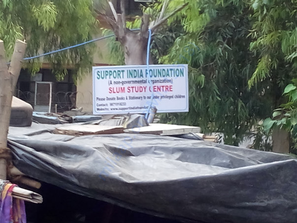 Board of Support India at Keshavpuram railway slum