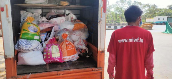 Volunteers in Mumbai ready to deliver food packets to the poor