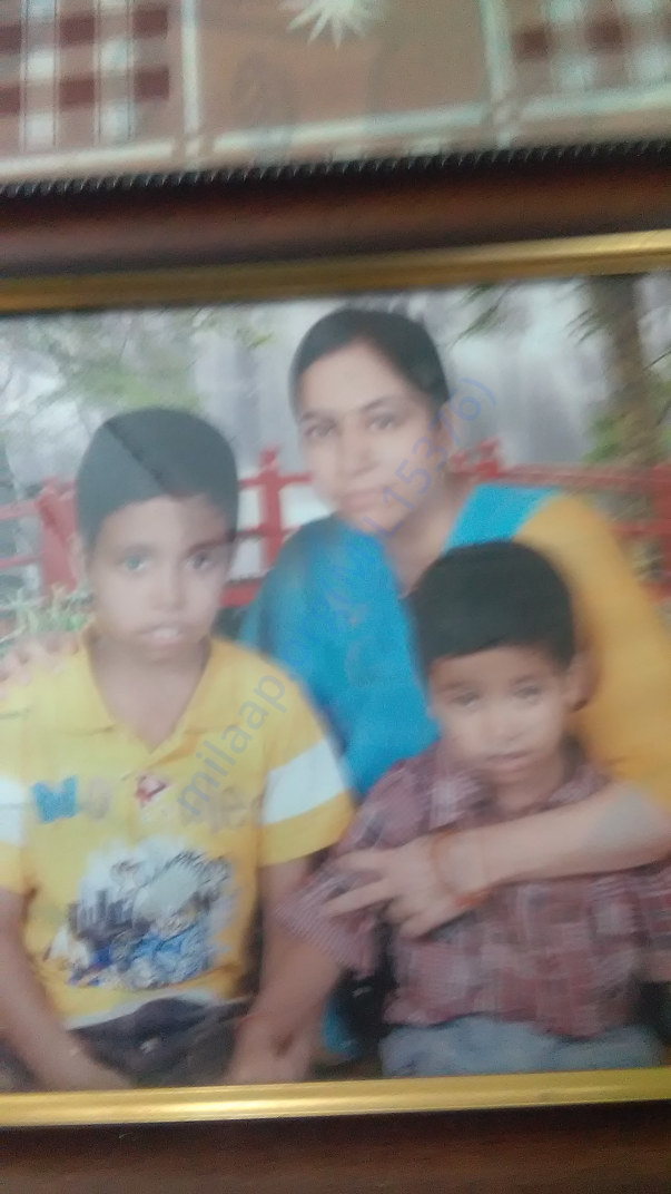 Baby Mihir with his mother and elder brother