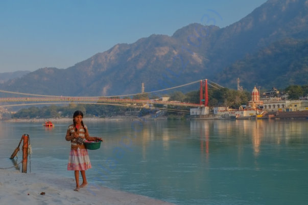 This is a photo I captured of Ram Jhula, Ma Ganga, and flower girl
