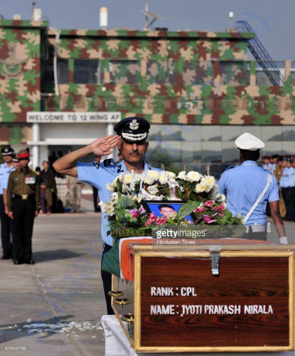 Senior Officer saluting the mortal remains