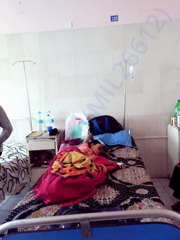 Dhanika in her bed at Dr. B. Borooah Cancer Institute