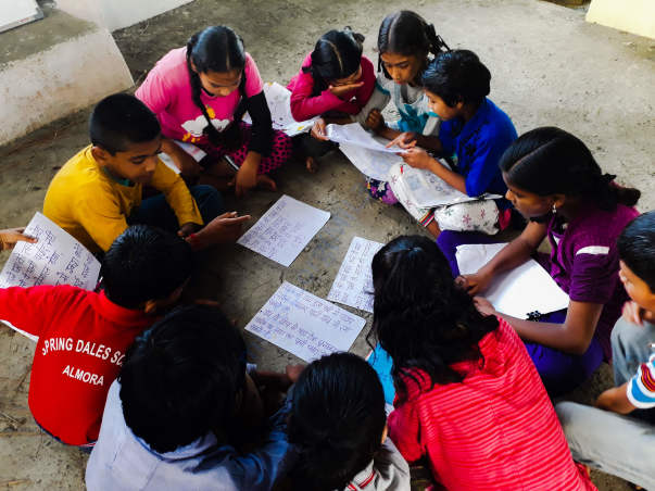 Children brainstorming solutions for water shortage in their village