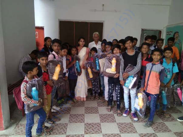 Pay Back To Society (Distribution of Bags And Bottles to Children's)