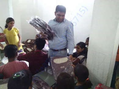 Pay Back To Society (Distribution of School Bags Among Children's)