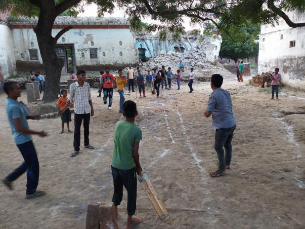 Boys team practicing and learning Cricket