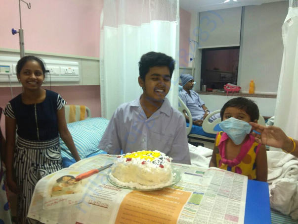 Dhruv cutting his birthday cake while in hospital
