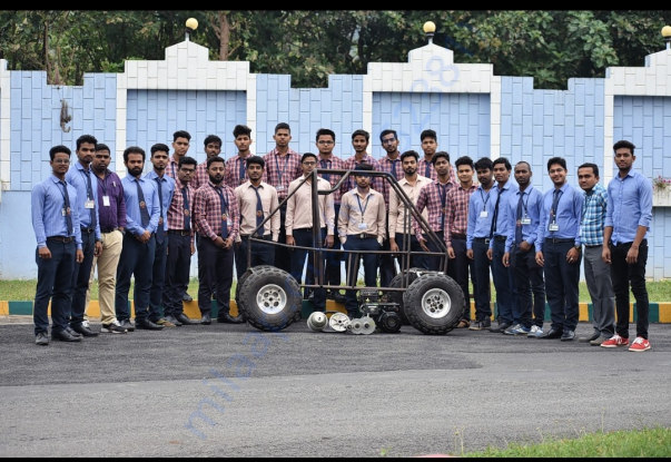 In picture showing rollcage with team members and faculty co-ordinator