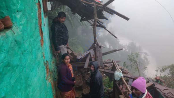 A tribal family who lost their home due to landsliding in cyclone
