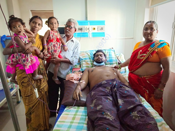 With his family when he was on hospital