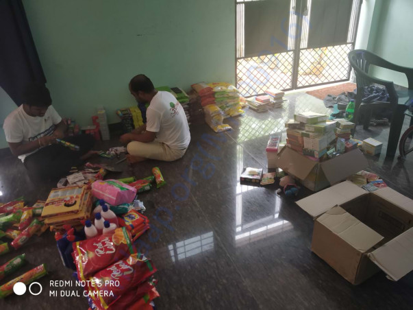 Packaging is going on for dry food for flood affected families