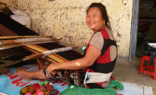 Nemjahoi weaving at her home.