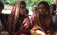 Rashida Sarkar and another lady are about to receive new solar lanterns