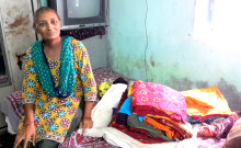 Rashidaben displays her stock of bandhani dress materials