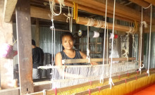 Lalramngaii happily weaving on her very own loom.