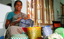 Gnanapushpam working with her wire bags