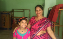 Lakshmi is with her granddaughter.