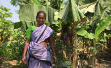 Gajalakshmi standing by her new piped-water connection