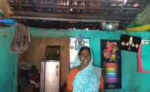 Chandravva in of her home with the newly constructed roof