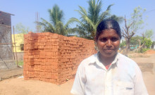 Mohanambal stands in front of her work site