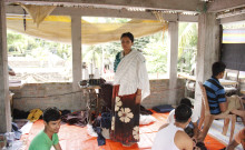 Tuhina stands on her terrace workshop with her workers