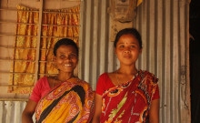 Kanchan and Dayamati stand outside their house