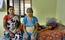 Kamladevi (to the right) sits with her daughter-in-law, while her grandson takes an afternoon nap.