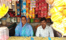 Geeta sits with her youngest son in the Kirana shop