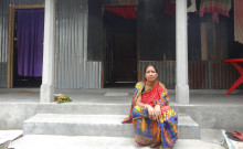 Susmita outside her home