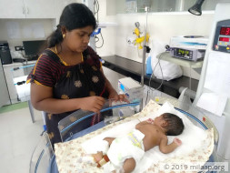 Arathi's six day old baby is in a critical state in the ICU