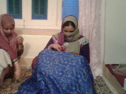Helping kashmiri women artisans for attending International Trade Fair