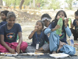 Help us feeding hungry children from slums