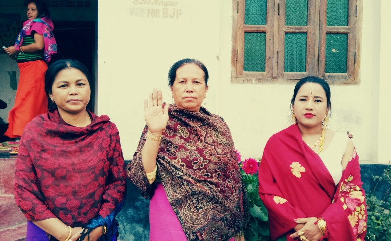 Dhanamanjuri(raised her hand) with her group members