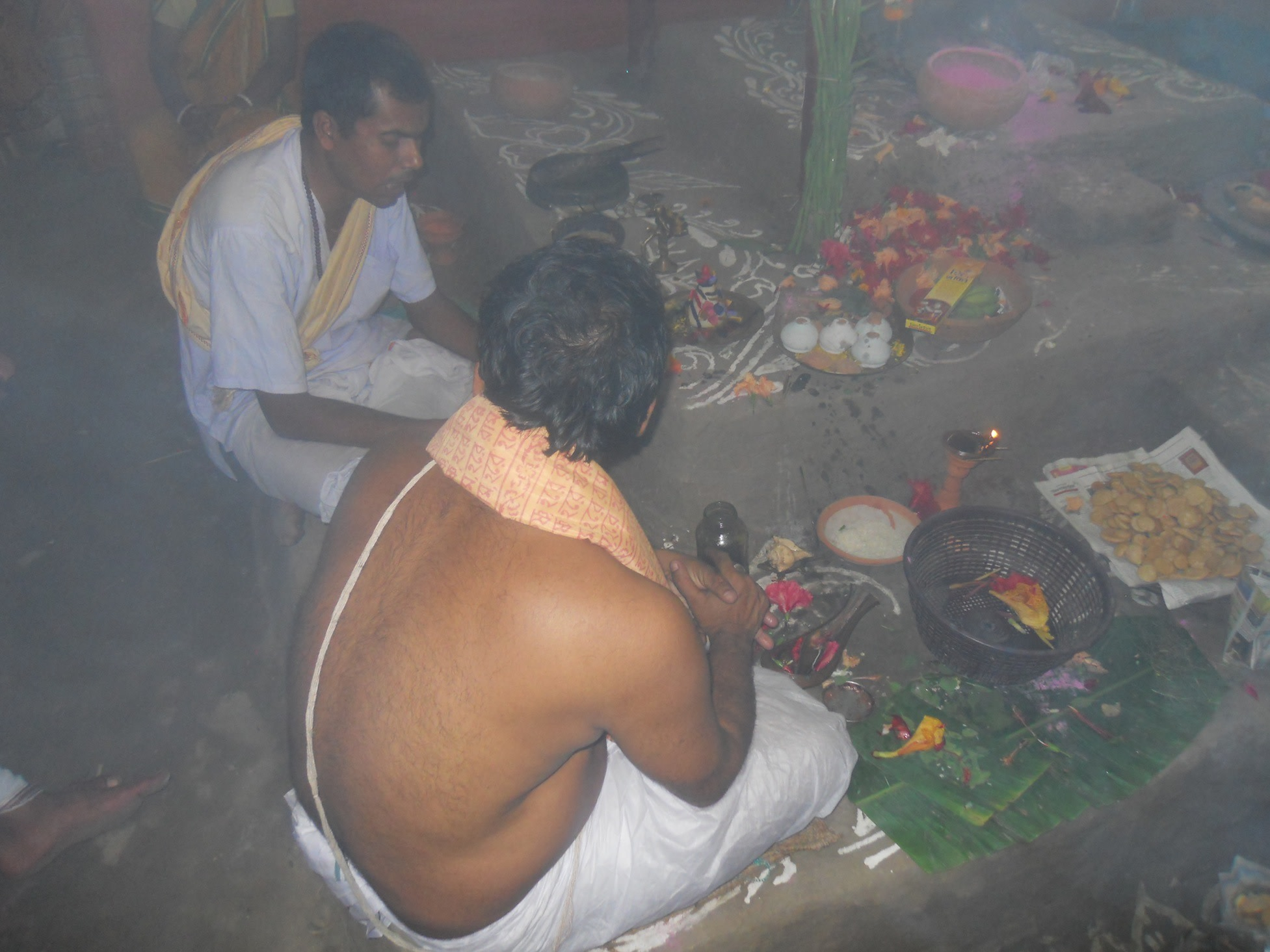 Priests chanting the melodic Hindu Sanskrit mantras as a form of 'Bhakti' (devotional worship) to Lord Krishna.