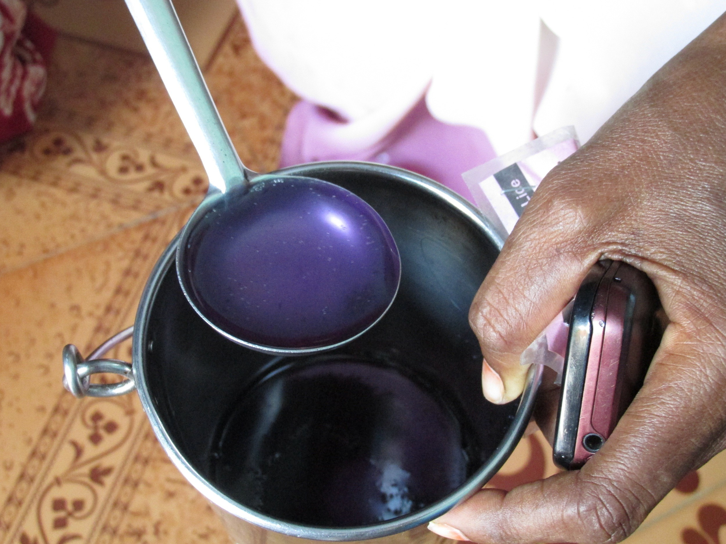 Pandiammal makes this deep purple all natural lice medicine for her village