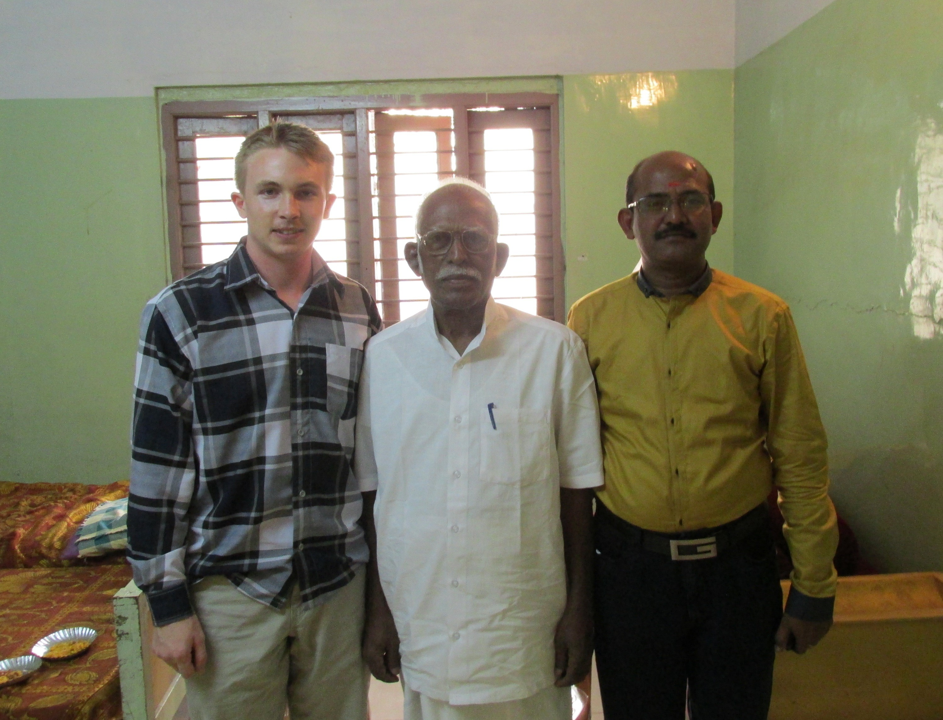 The Headmaster (right), Gurunathan (center), and me