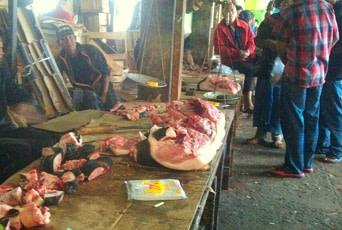 Butchers selling pork