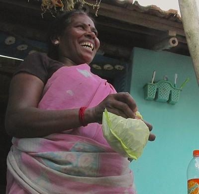 Rani tying the bag of boiled peanuts