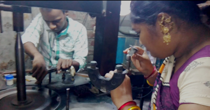 Workers polishing artificial diamond
