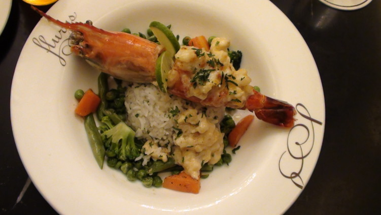 Prawn Thermidor with sautéed vegetables and herb rice