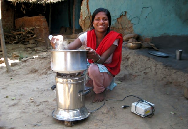 Borrower with cookstove in Muniguda