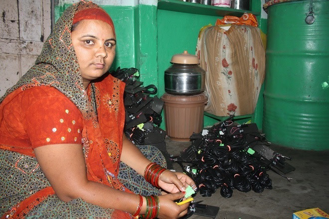 High-school educated Rajniben, a mother of 2 from rural Gujarat, assembles sewing machines with her bare hands.