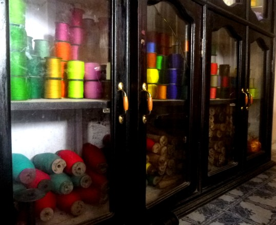 Threads of various colours used for weaving.