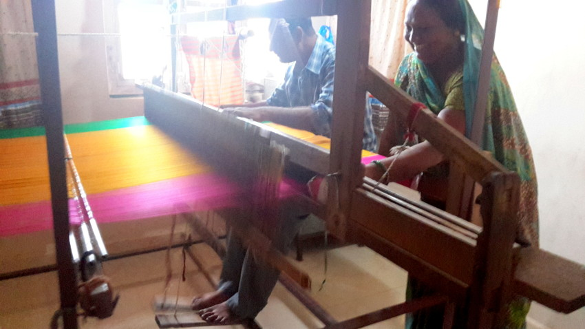 Vinodbhai and his wife engrossed in making the beautiful Patola sari