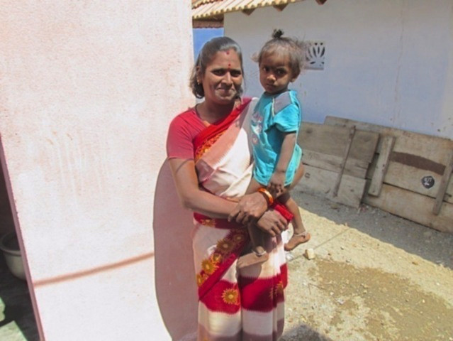 Indhumathi in front of her toilet