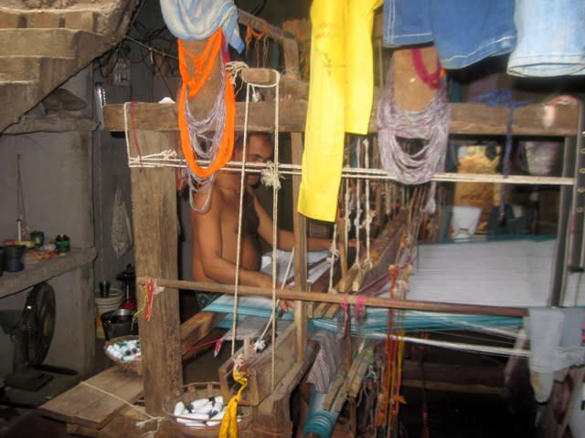 The take up roll is seen at the bottom of the handloom.