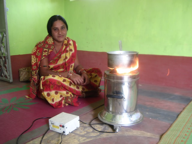 Sabitri Rana preparing tea using the new cook stove
