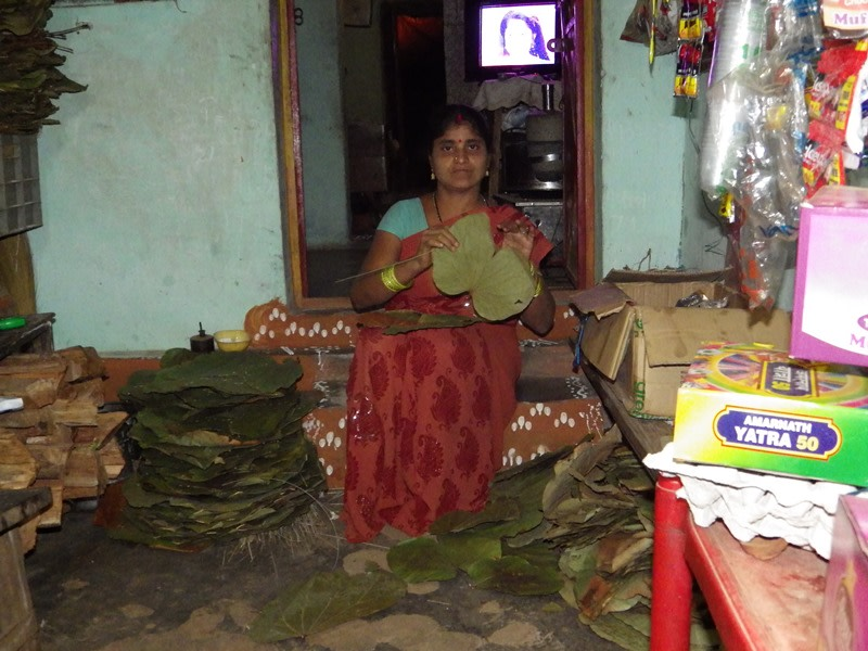 Padma at her home making leaf plates
