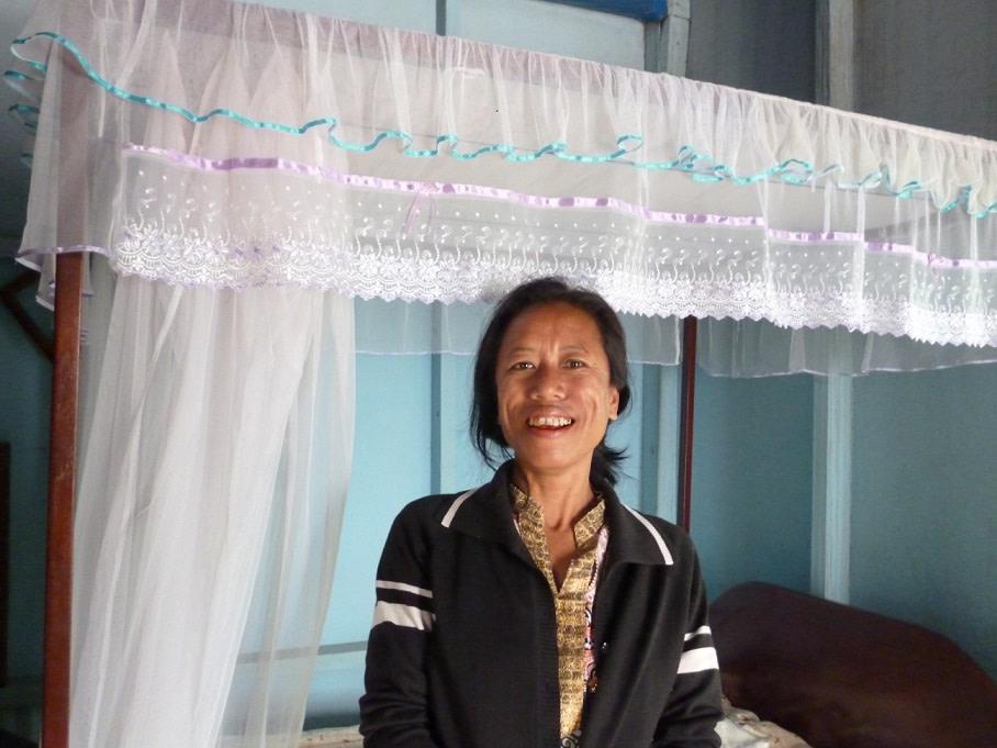 Zatluangi uses her tailoring skills to sew stylish mosquito nets.